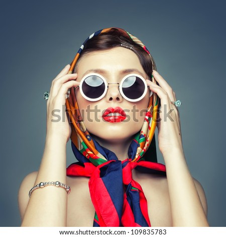 Stock Photo The square image of a girl in retro handkerchief