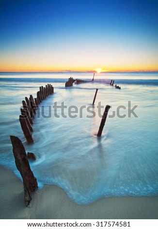 The SS Dicky at sunrise. Shipwrecked on Dicky Beach, Queensland, Australia. #317574581