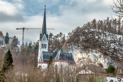 The St  Martin's Parish Church on a snowy day in Bled, northwestern Slovenia in winter