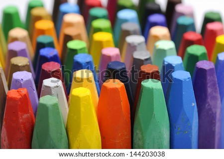The stacks of crayon shot over white background