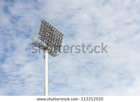 The Stadium Spot-light tower over Blue Sky - stock photo