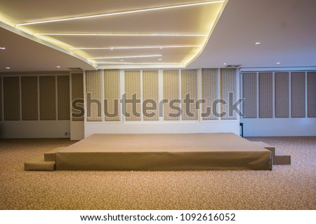 The stage is in the conference room. Stage and room. Empty room and small stage #1092616052
