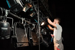 The stage worker sets up the lights