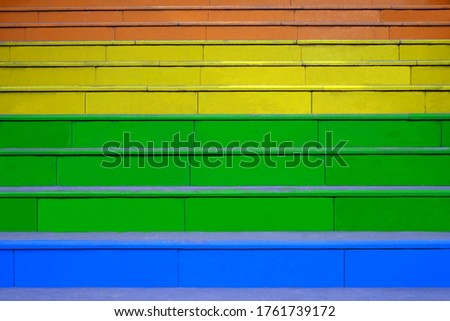 The staircase is painted in rainbow colors.