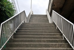 The stairs to the floating bridge that the handle is made of stainless steel