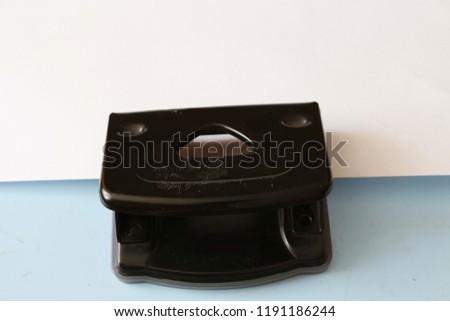 The stapler staples the paper