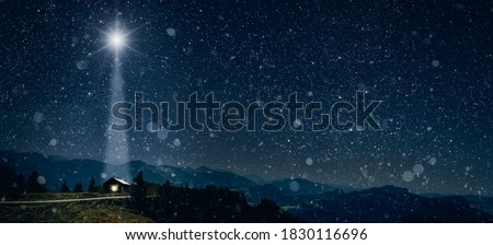 Photo of  The star shines over the manger of christmas of Jesus Christ.