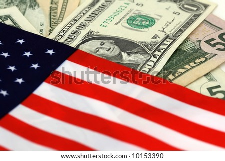 The stars and stripes with dollar bills of the USA