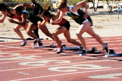 The start of the woman's 100 meter dash at a college track meet.