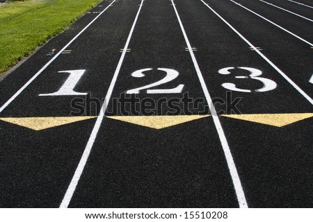 The starting line of the first 3 lanes of a track competition.