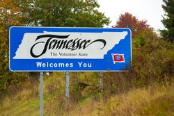 The state of Tennessee welcomes you to The Volunteer State with a sign on the highway