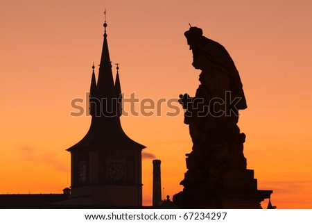 The statue and famous tower on Charles Bridge in Prague in Czech Republic
