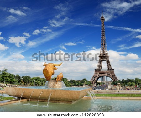 The statue Bull and Calf on Trocadero fountain and Eiffel tower in Paris, France.