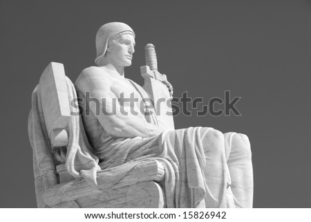 The statue called The Authority of Law at the entrance to the US Supreme Court in Washington, DC. - stock photo