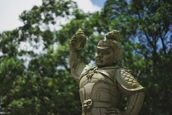 The statue in the park at foot of mountain of Tian Tan Buddha in Ngong Ping, the popular landmarks of Hong Kong