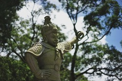 The statue in the park at foot of mountain of Tian Tan Buddha in Ngong Ping, the popular landmarks of Hong Kong.