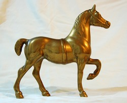 The statue of a horse made of brass
