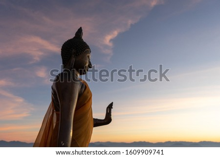The statue of Buddha with twilight sky