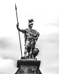 The statue of Fortitude decorating Dublin Castle, Ireland. Black and white background.