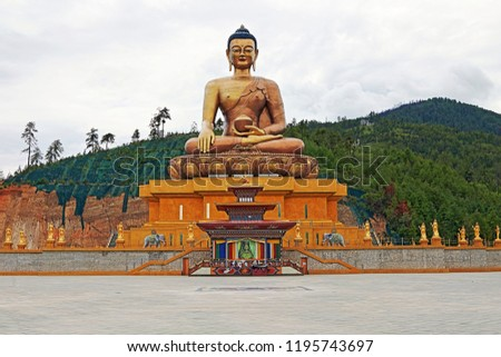 The statue of Great Buddha Dordenma at Buddha Point, on a hill overlooking the Thimphu Valley in Thimphu, Bhutan.  It stands at 168 feet, making it one of the largest Buddha statues in the world.