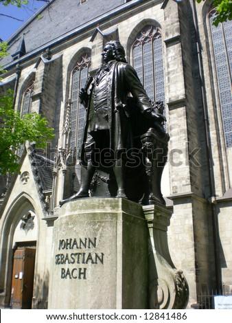 the statue of johann sebastian bach in front of saint thomas church, leipzig, germany