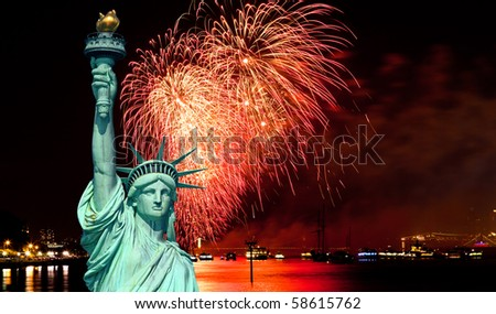 The Statue of Liberty and July 4th fireworks over Hudson River