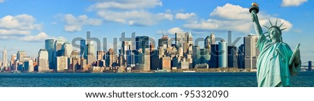 The Statue of Liberty and Manhattan New York City Skyline panorama