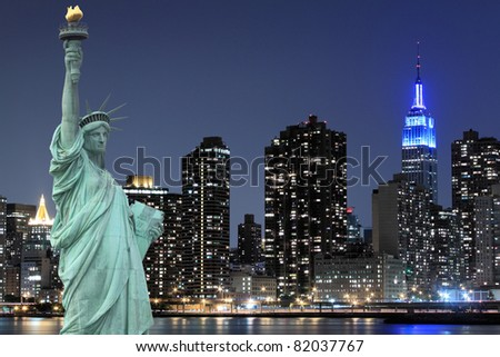 The Statue of Liberty and Manhattan skyline, New York City - stock photo