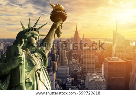 The Statue of Liberty and New York City skyline at dark stock photo