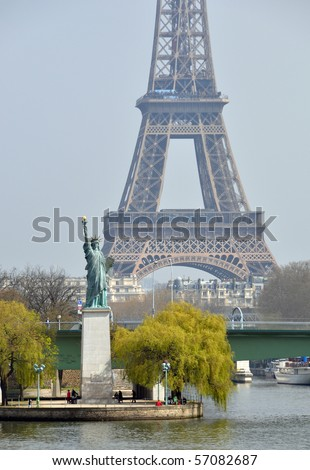 The Statue of Liberty and the Eiffel Tower - stock photo