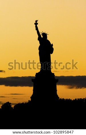 The Statue of Liberty at sunset in New York city.