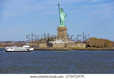 stock-photo-the-statue-of-liberty-lit-by-the-early-morning-sunrise-273472979.jpg