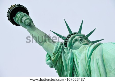 The Statue of liberty Manhattan, New York, USA.low angle isolated on blue sky background.