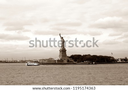 The Statue of Liberty on Liberty Island in the New York Harbor, New York City, USA in sepia tones