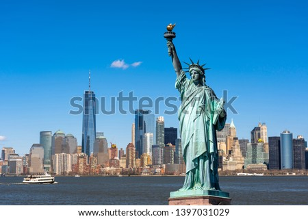 The Statue of Liberty over the Scene of New york cityscape river side which location is lower manhattan,Architecture and building with tourist concept #1397031029