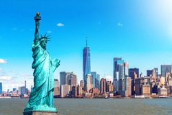 The Statue of Liberty with the One world Trade building center over hudson river and New York cityscape background, Landmarks of lower manhattan New York city. Architecture and building concept