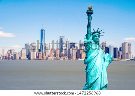 The Statue of Liberty with the One world Trade building center over hudson river and New York cityscape background, Landmarks of lower manhattan New York city.