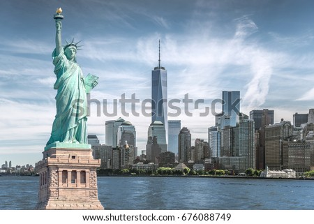 The statue of Liberty with World Trade Center background, Landmarks of New York City #676088749
