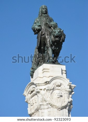 The statue of marquis de Pombal with a lion in Lisbon in Portugal