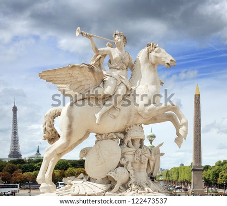 The statue of Renommee, or the fame of the king, riding the horse Pegasus (by Antoine Coysevox) at the west entrance of the Tuileries Garden in Paris, France.
