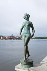 The statue on the river side of the Stockholm city hall