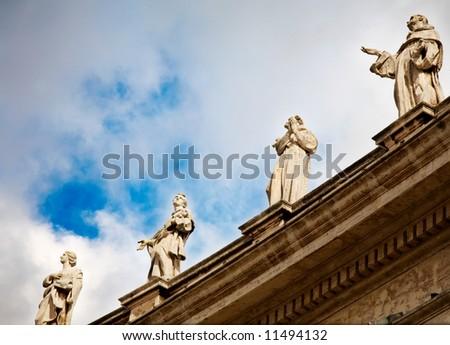 The statues of Vatican Bernini's colonnade, Saint Peter's dome (Basilica di San Pietro) Vatican City, Rome, Italy.