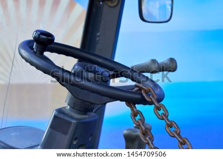 The steering wheel of a vehicle has been chained as a anti-theft measure                             #1454709506