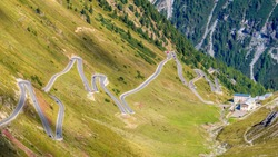 The Stelvio Pass is a mountain pass in the Ortler alps in South Tyrol (Northern Italy) and connects to the Swiss Umbrail pass towards the Val Müstair. It has a total of seventy-five hairpin turns