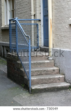 The Steps to the Back Door of a Building