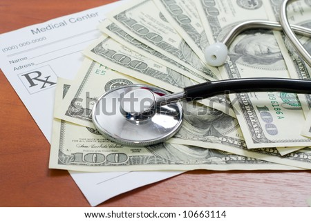 The stethoscope lays on a pile of dollars and the recipe