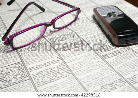 The still-life consisting of the newspaper and glasses.