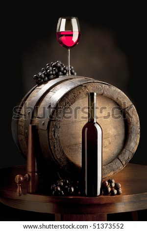 the still life with red wine, wine glass and old barrel
