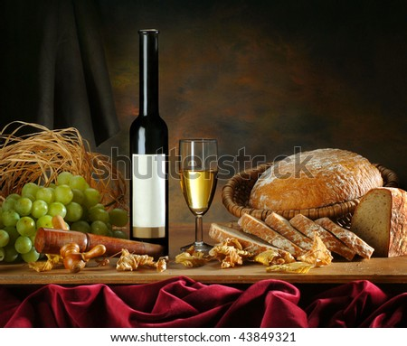 The still-life with white wine and vine