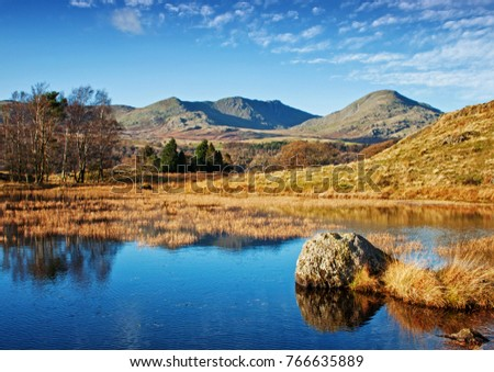 The stillness of Kelly Hall Tarn, with the old man of Coniston gracing the background